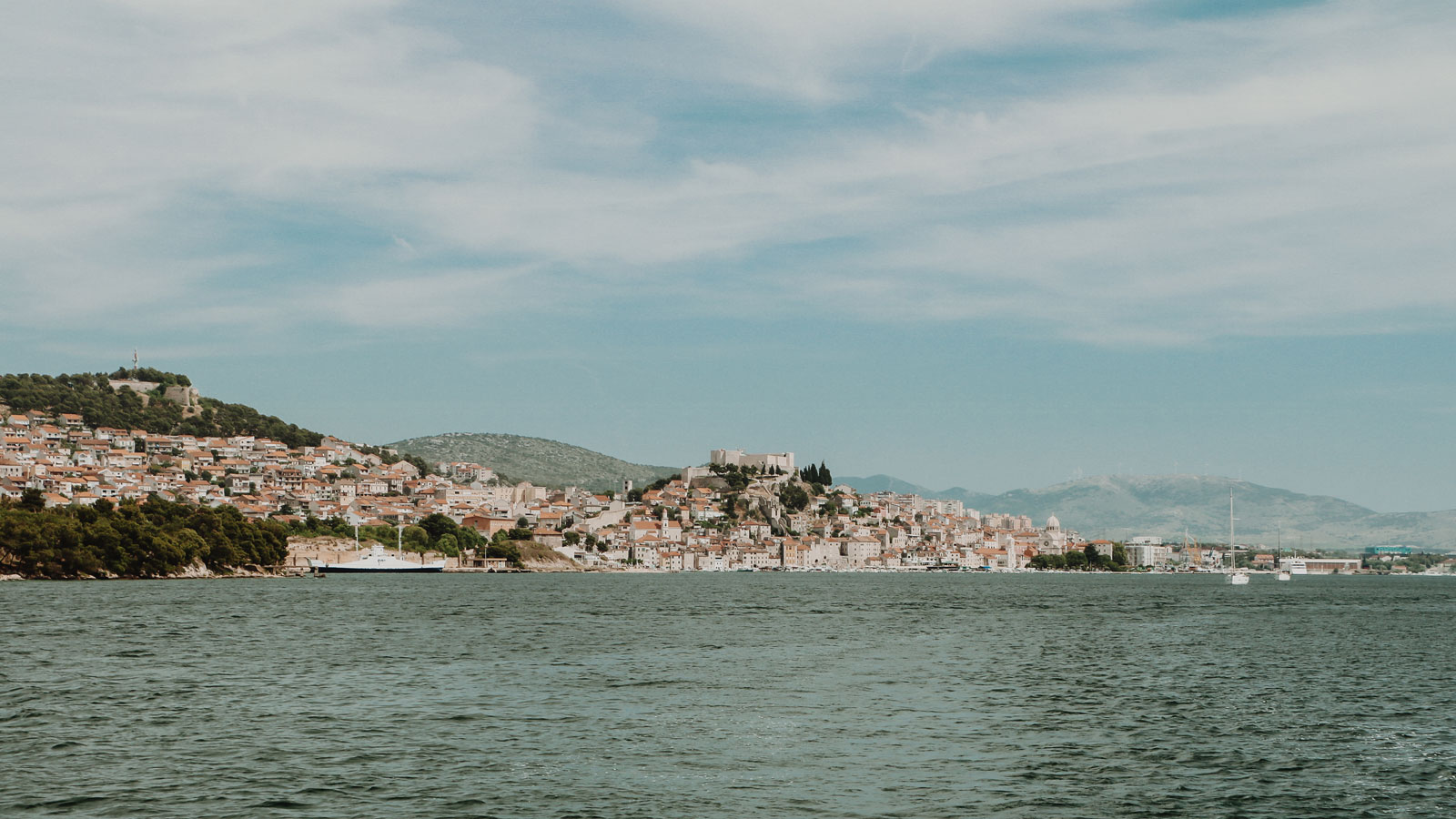 Sailing past Sibenik on a yacht holiday