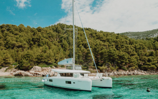 Charter a Private yacht - Catamaran moored in a bay in Croatia on a sailing holiday